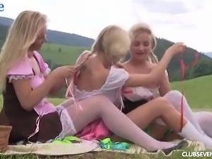 Three sexy girls in dirndl skirts enjoy picnic and outdoor masturbation