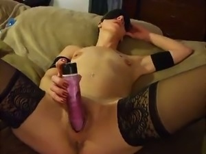 Using a bright pink toy torrid lady in black stockings teases her own twat