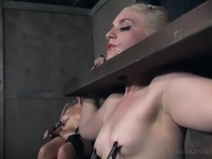 Obedient pale blondie Dresden gets locked in the stocks and treated in hard mode