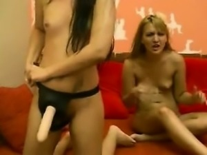 Blonde and brunette lesbian having fun using strapon