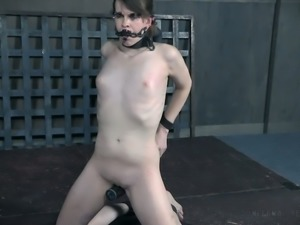 Brunette white girl clipped and pinned with paper clips and chained to the pole