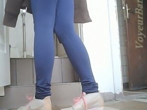 Sweet white blondie in tight blue jeans pissing in the toilet