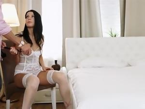 Brunette woman in white lingerie cannot resist a big boner