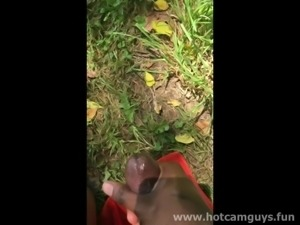 Black guy jerks off and cums outdoor laying on a blanket in the grass