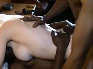 Double penetration of a blonde in interracial threesome