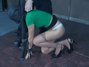 Flexible MILF Alana Cruise is behind the bars and teased with metal hook