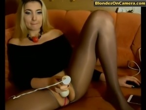 Blonde whore in pantyhose with cut hole masturbates her pussy with a dildo