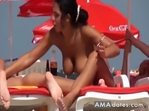 Young lady lying on the beach tried to become a tan and massage