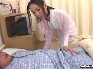Sexy Japanese nurse Mika Kojima sucks and wanks her patient's dick
