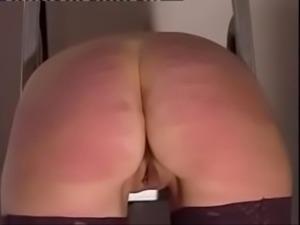 Female-caned-hard-tied-over-steps