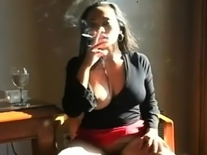 Gal enjoys a cigarette while putting a cock in her throat