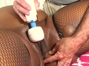 Curly haired ebony BBW Peaches doesn't mind having nice erotic massage