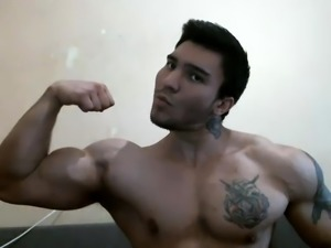 Muscled hunk shows off his body and strokes his big dick