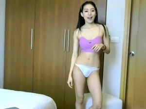 Ravishing Japanese camgirl fucks a dildo and sucks a cock