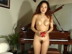 Sexy red lace bra holds her perky Asian titties