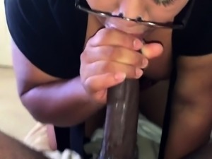 Curvy ebony lady with glasses sucks a huge black dick in POV