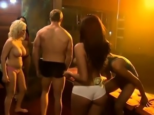 Hot women pole dancing and teasing dudes while naked