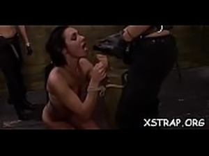 Appetizing brunette loves it when that babe is roughed and roped in bondage