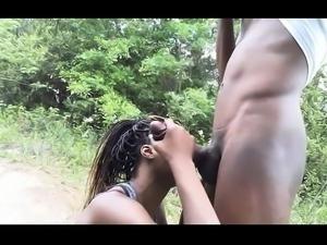Striking ebony girl sucks and fucks a big black cock outside