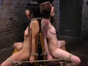 Tied up Asian nympho has to eat shaved pussy of Anna De Ville during BDSM