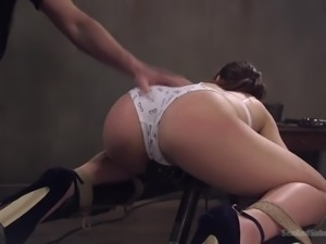 Fantastic bootylicious Kimber Woods gets tied up with ropes to the table