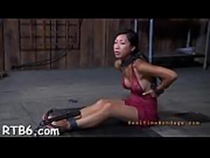 Lusty babe is tying up ravishing babe for castigation session