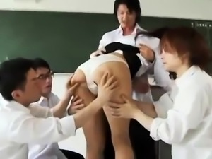 Busty Asian teacher enjoys a gang of cocks in the classroom