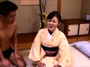 Stacked Oriental granny has a young man banging her snatch