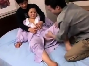 Voluptuous Japanese housewife gets banged rough by two boys