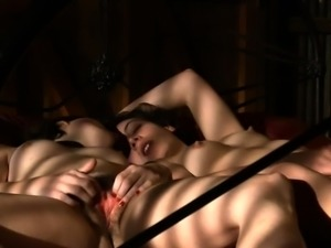Two horny lesbians kiss each other and masturbate on the bed