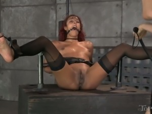 Restrained slut with gag in her mouth gets punished hard
