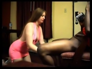 Bodacious brunette wife kneels down and pleases a black cock