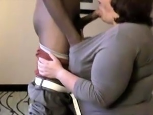 Curvy mature brunette has a black guy fulfilling her needs