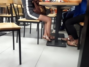girl sexy legs hot feets miniskirt under table
