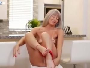 Grey haired cougar Leilani Lei pets her own mature pussy nonstop