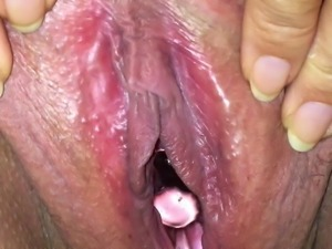 Pushing pussy close up
