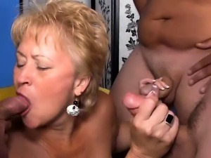 Mature Blonde Sucking Three Dongs at Once