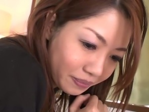 Asian porn model Rika Minamino spreads legs wide to expose her stretched...