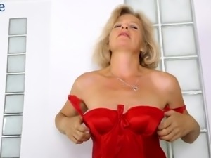 Diana Gold looks good in her red stuff while teasing her hairy cunt