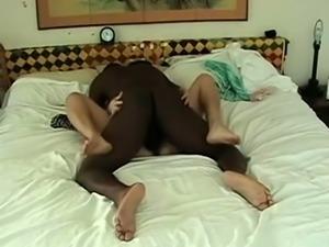 Alluring brunette milf has a black stud drilling her peach