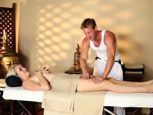 Cute blonde seduced by hunky masseur
