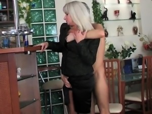 Stacked blonde cougar in lingerie can't resist a young cock