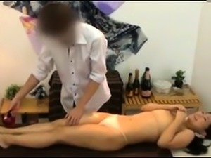 Gorgeous Japanese babe surrenders her wet pussy to a masseur
