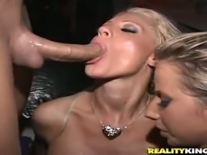 Two slutty blonde chicks suck and ride dick right in a club