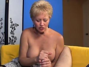 Mature blonde jerks cock